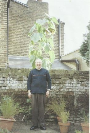 Peter in his garden with a sunflower