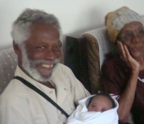 Daddy and Ma, with a new member of the family.