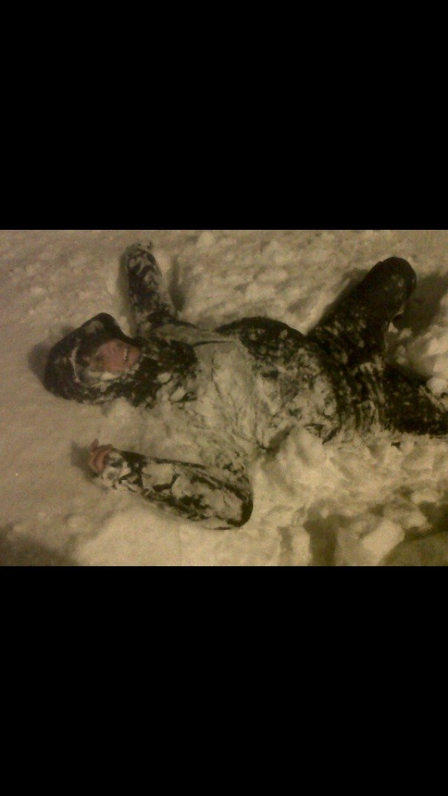 Josh messing in the snow on the way home from work