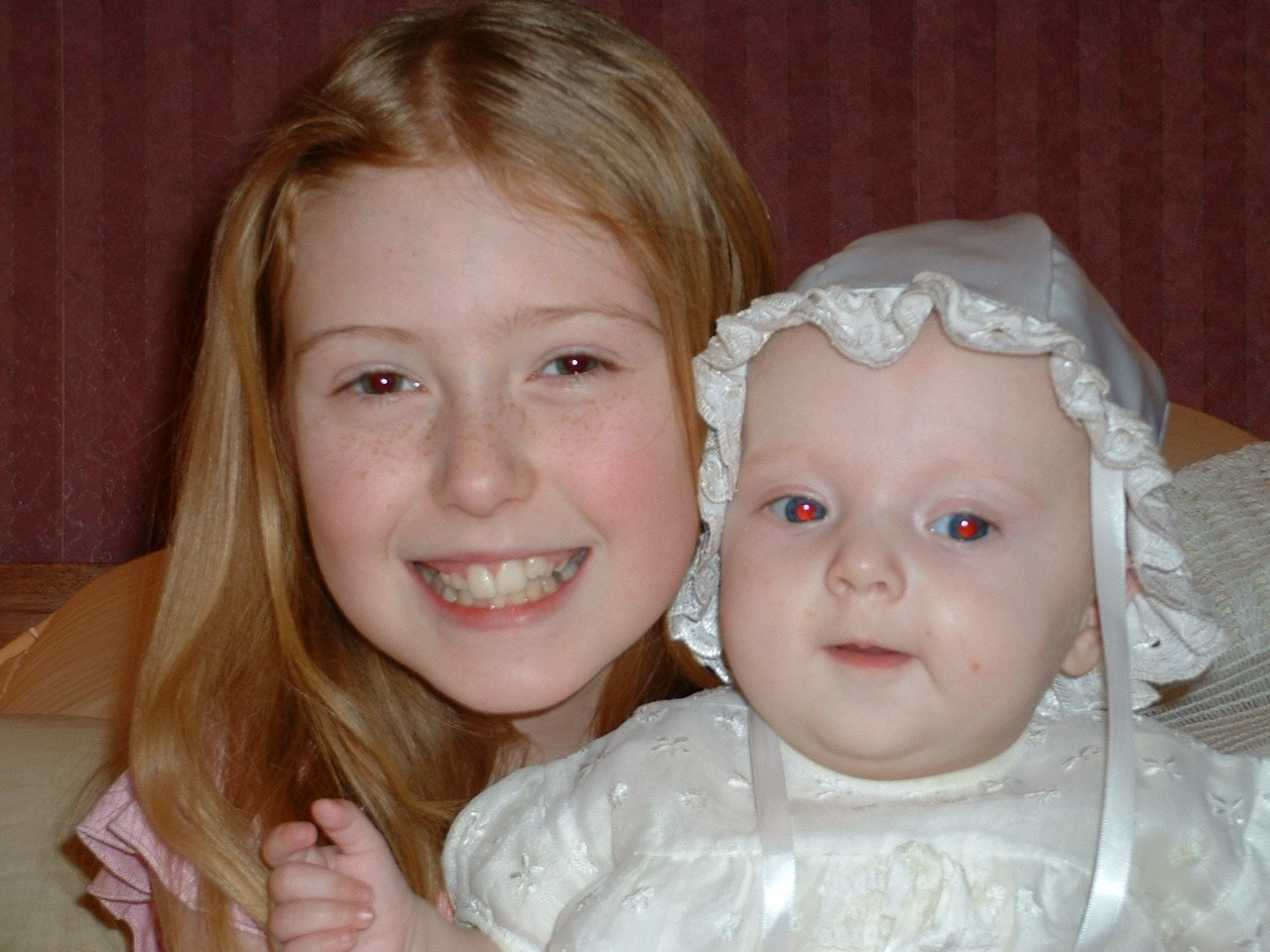 orla and her big sis on her christening day
