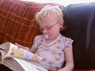 orla doing a bit of reading - aged 3