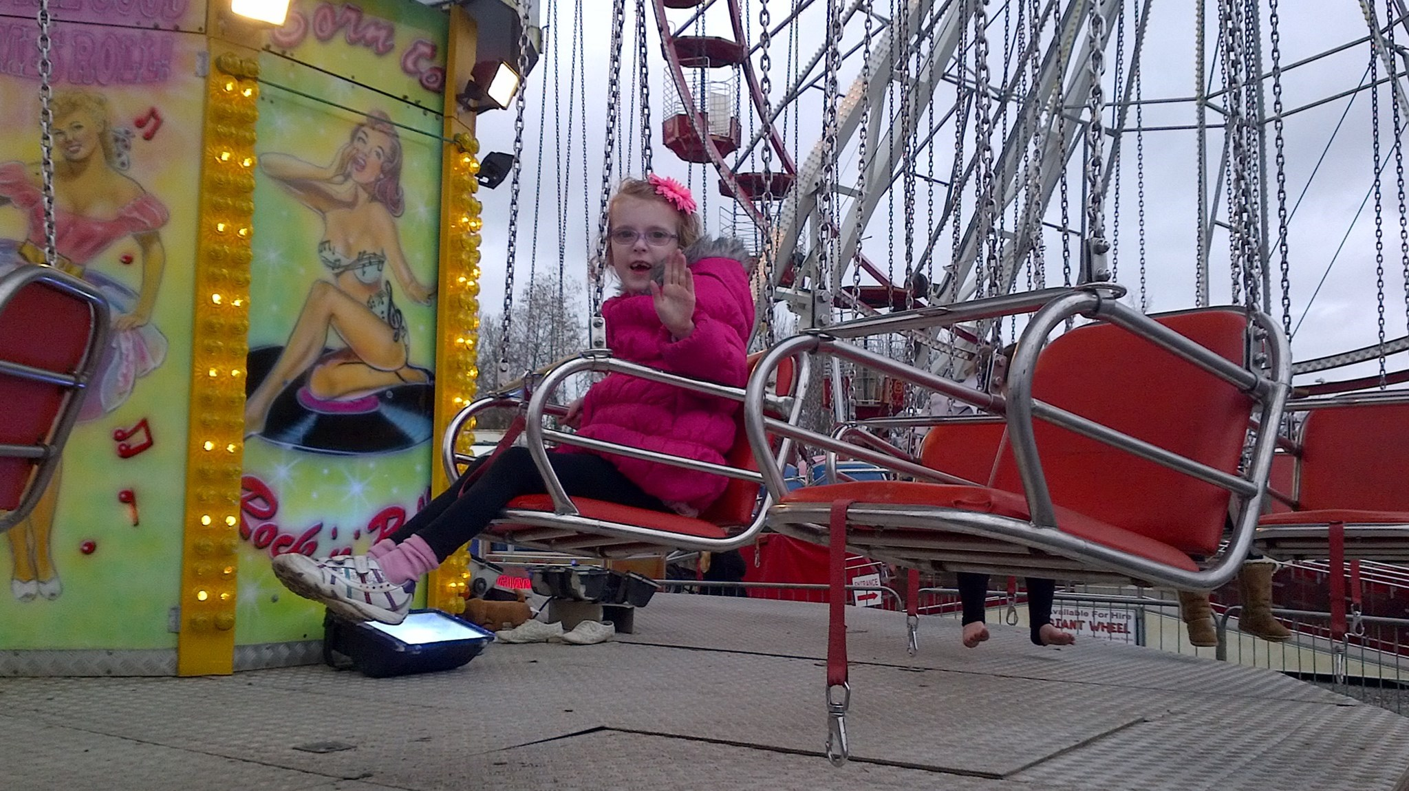 orla loved this swing at the fairground and went on it over and over