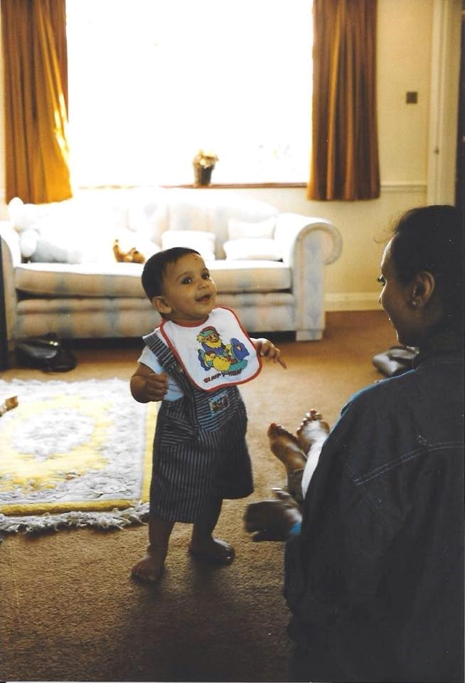 Summer 1995. Rakesh learns to walk. Same sweet smile. Forever in our hearts.