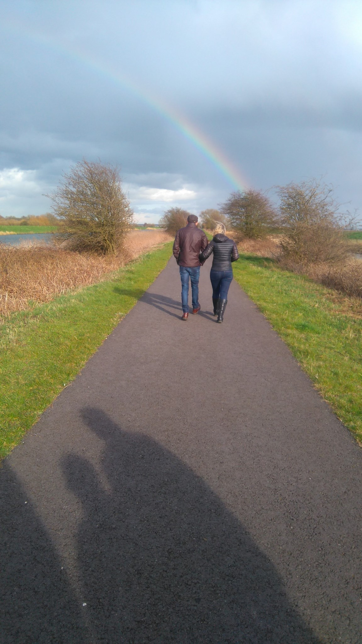 Loving Jeff and Amanda Walking Towards the Rainbow