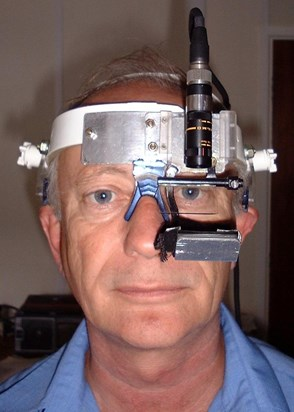 Mike in 2001 wearing one of the eye trackers he built in the late 1990s