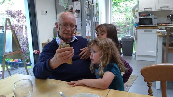 Looking at a stag beetle with grandchildren kew 2019