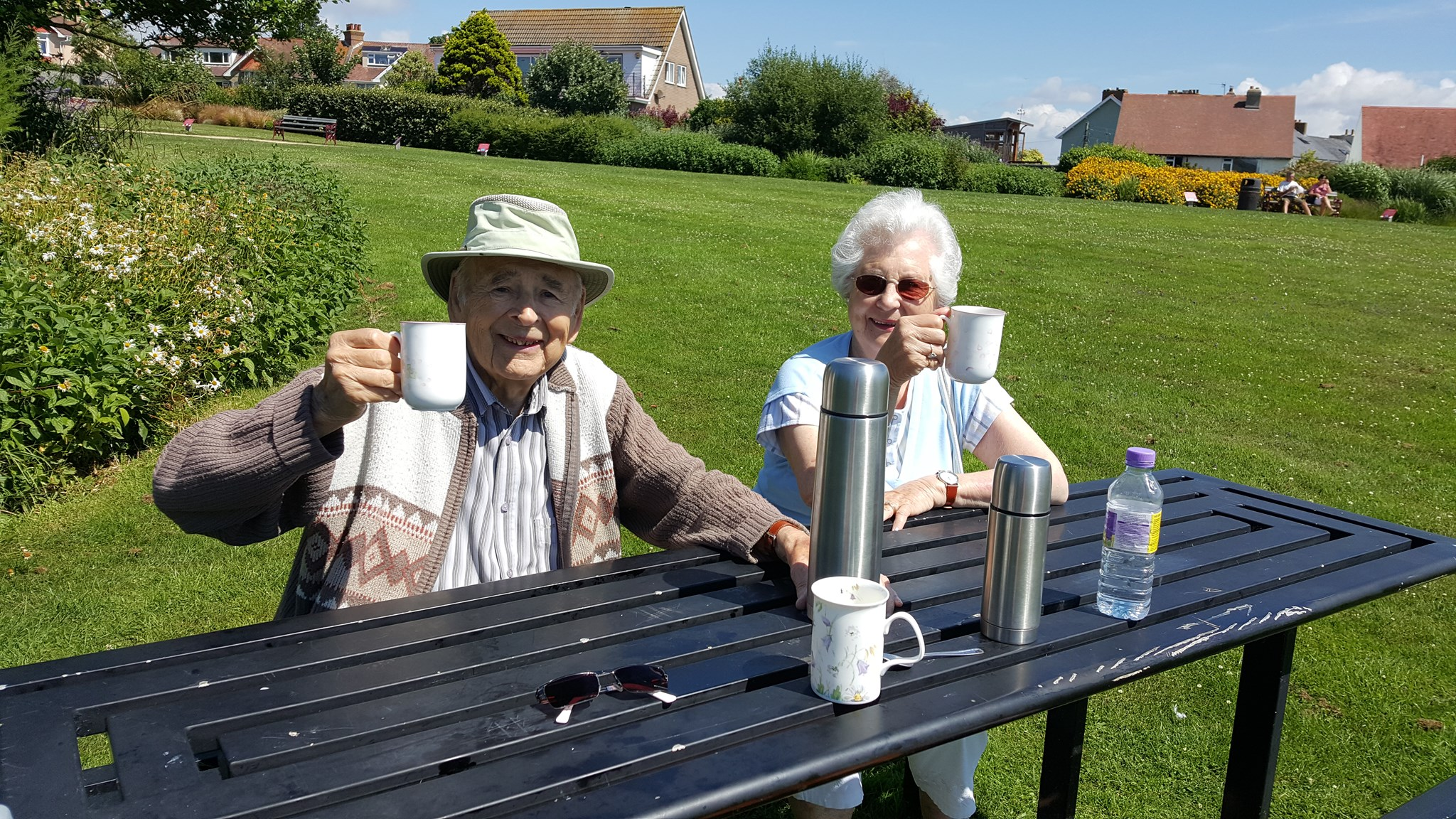 Dad and Mum in the park enjoying a cup of coffee!