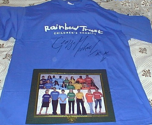 Back in March 2004 George was kind enough to give us his own Rainbow Trust tshirt,signed so we could auction it at a fan meeting to celebrate the release of Patience. Proceeds (doubled by George) of course went to Rainbow Trust