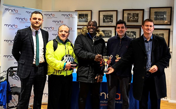 Len presents the winners trophy to a team of MPs from the All-Party Parliamentary Group on Football.