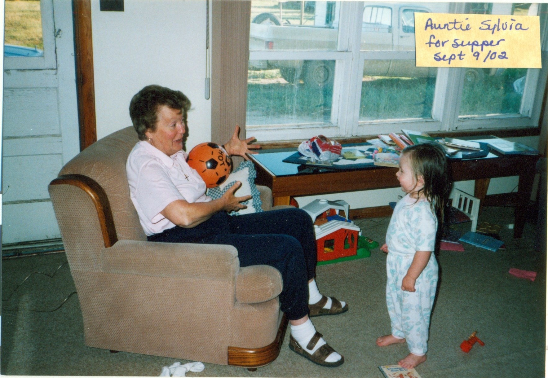 Great Auntie Sylvia and Lydia playing catch in 2002