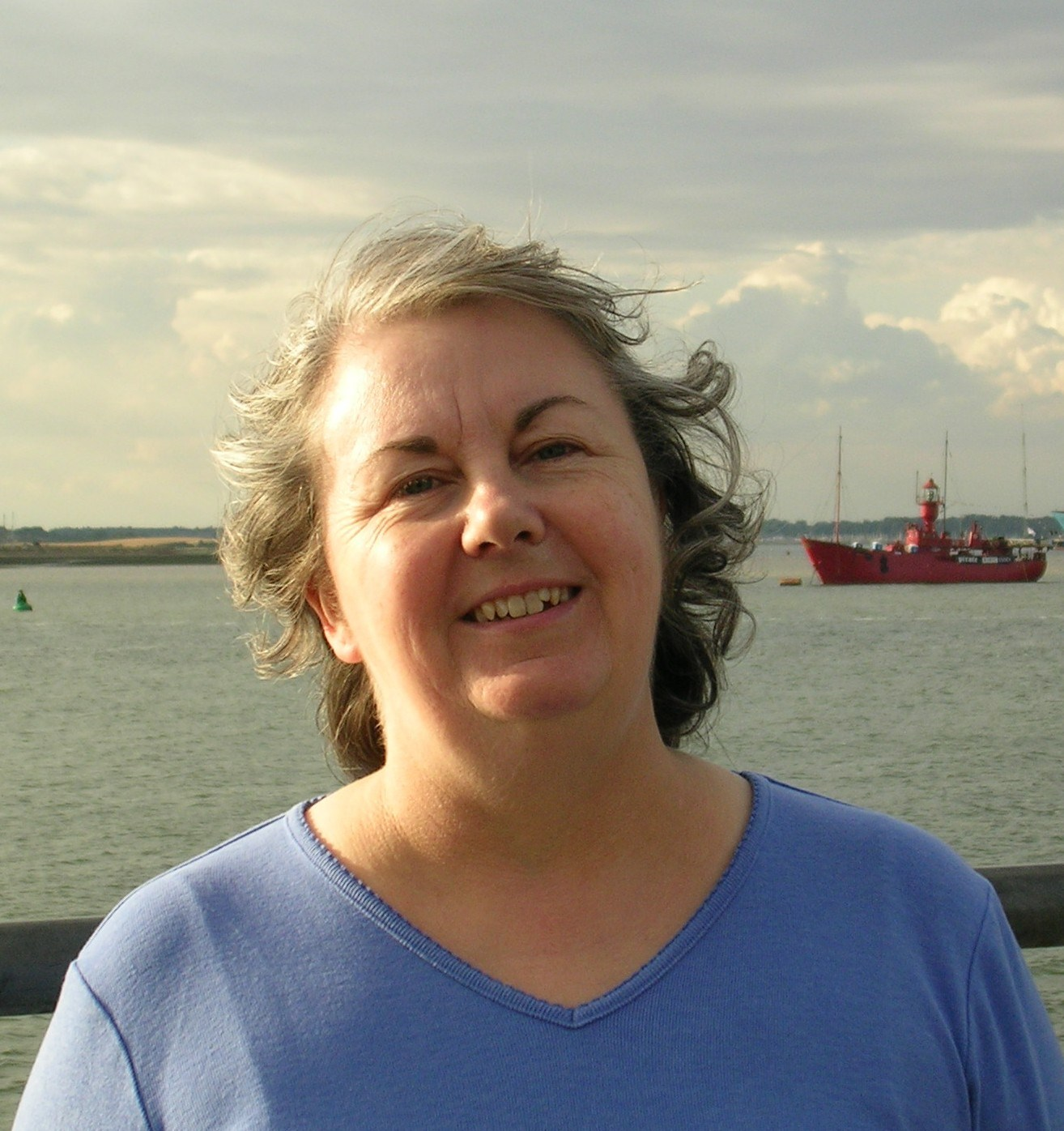 A happy Linda, a few years ago, on a visit to her beloved Radio Pirates at Harwich.