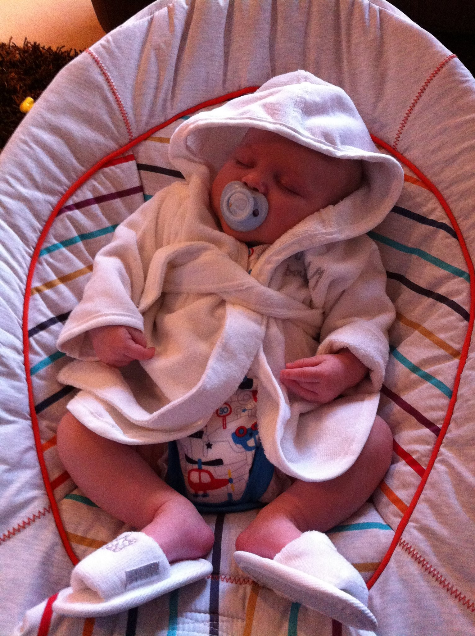 Henry having a nap in his robe and slippers, bought by friend  Shelly. December 2012