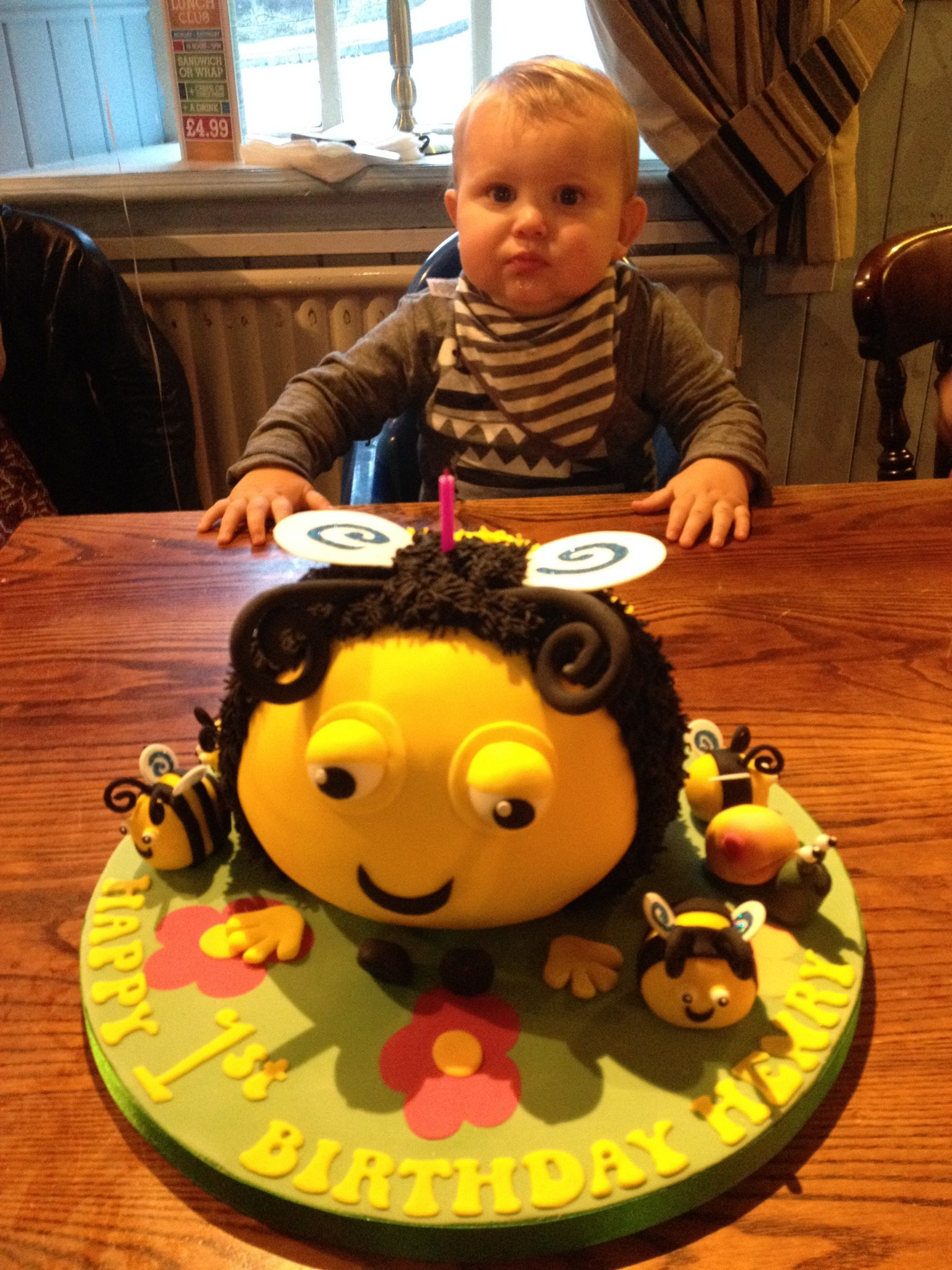 "Henry's 1st birthday. He loved ""The Hive"" so we had a Buzzbee cake made by friend Mandy."