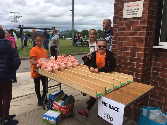 Tilly & Evie on the Pig Race stall