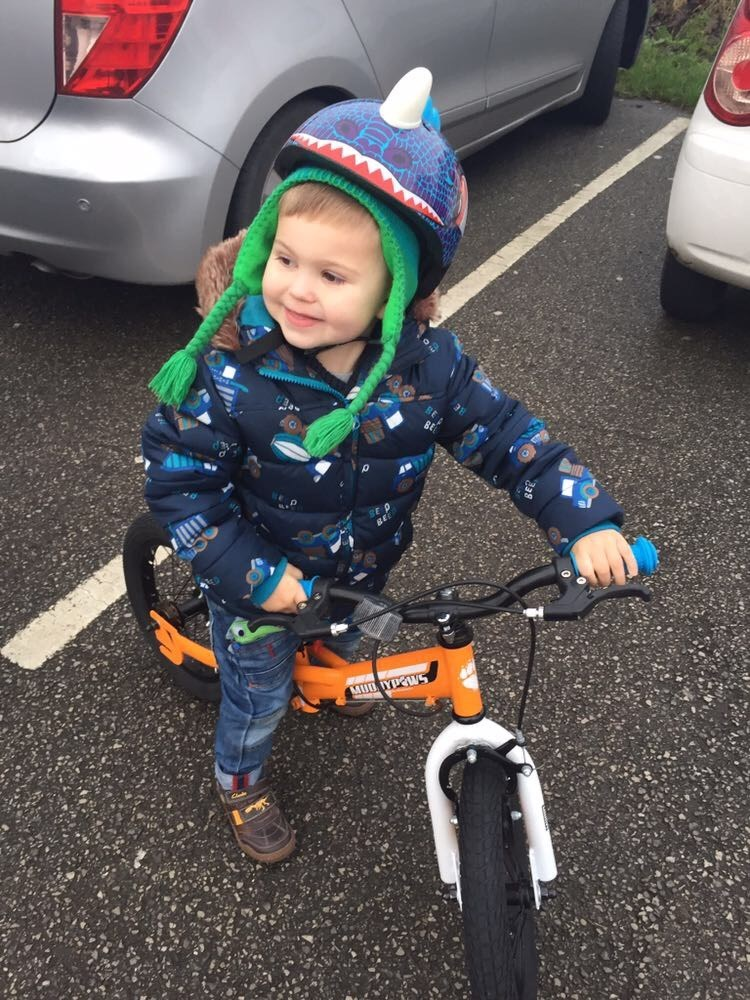Henry on his new bike he got for Christmas. New Years Day 2016. The only time he got to try it out.