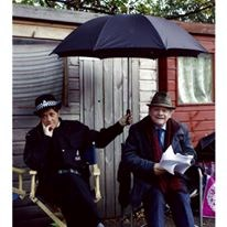 Lucy and David Jason on the Frost set, taking a break because of the rain. The picture appeared as a full page spread in the Radio Times