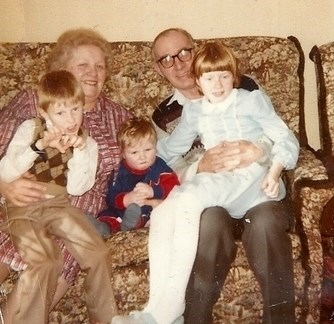 May & Jim with three of their grand children