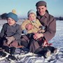 Mike with dad Geoff and brother Ian.  He started the tobogganing and snow fascination early!