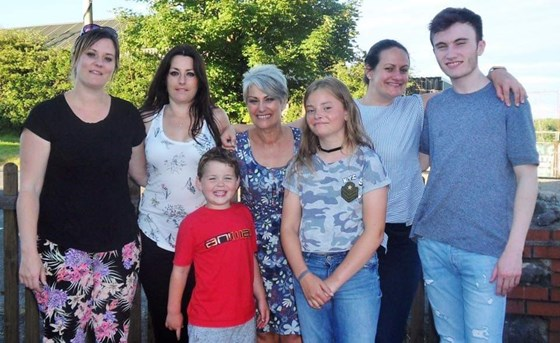 Mum with all her children and 2 grandchildren