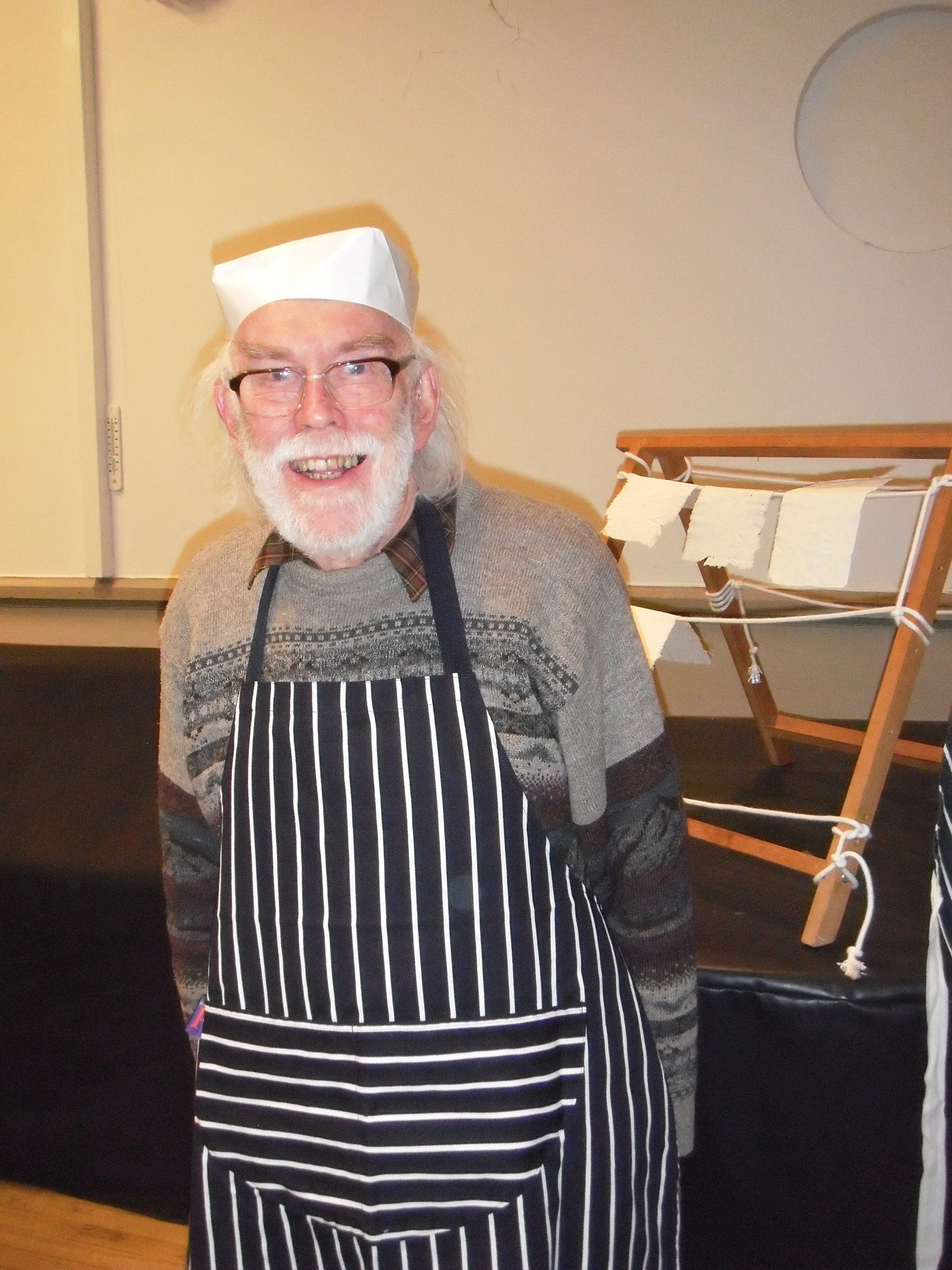 Alan wearing his paper hat while demonstrating paper making, 2015
