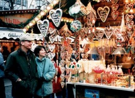 Bill and Andrea admiring the sweets at the Christmas market in Germany