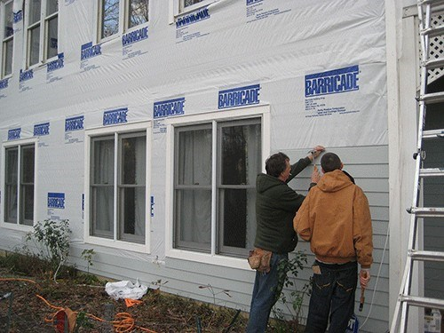 Brian and Dad Siding a Home