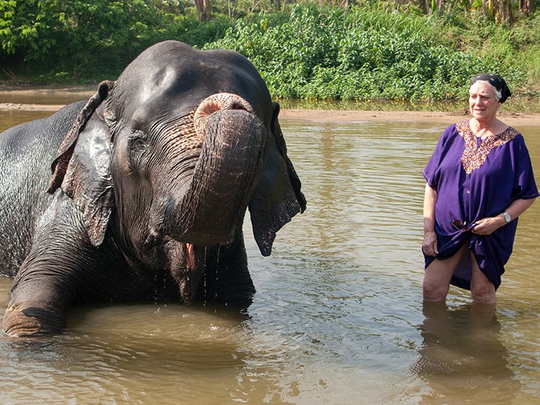 Sonia and bathing elephant in Tamil Nadu, India 2009