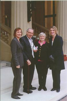 Receiving his MBE with Anna and two daughters