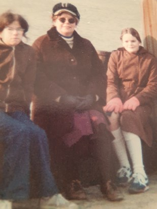 Dawn man and sister wrapped up warm on walk late 70s early 80s