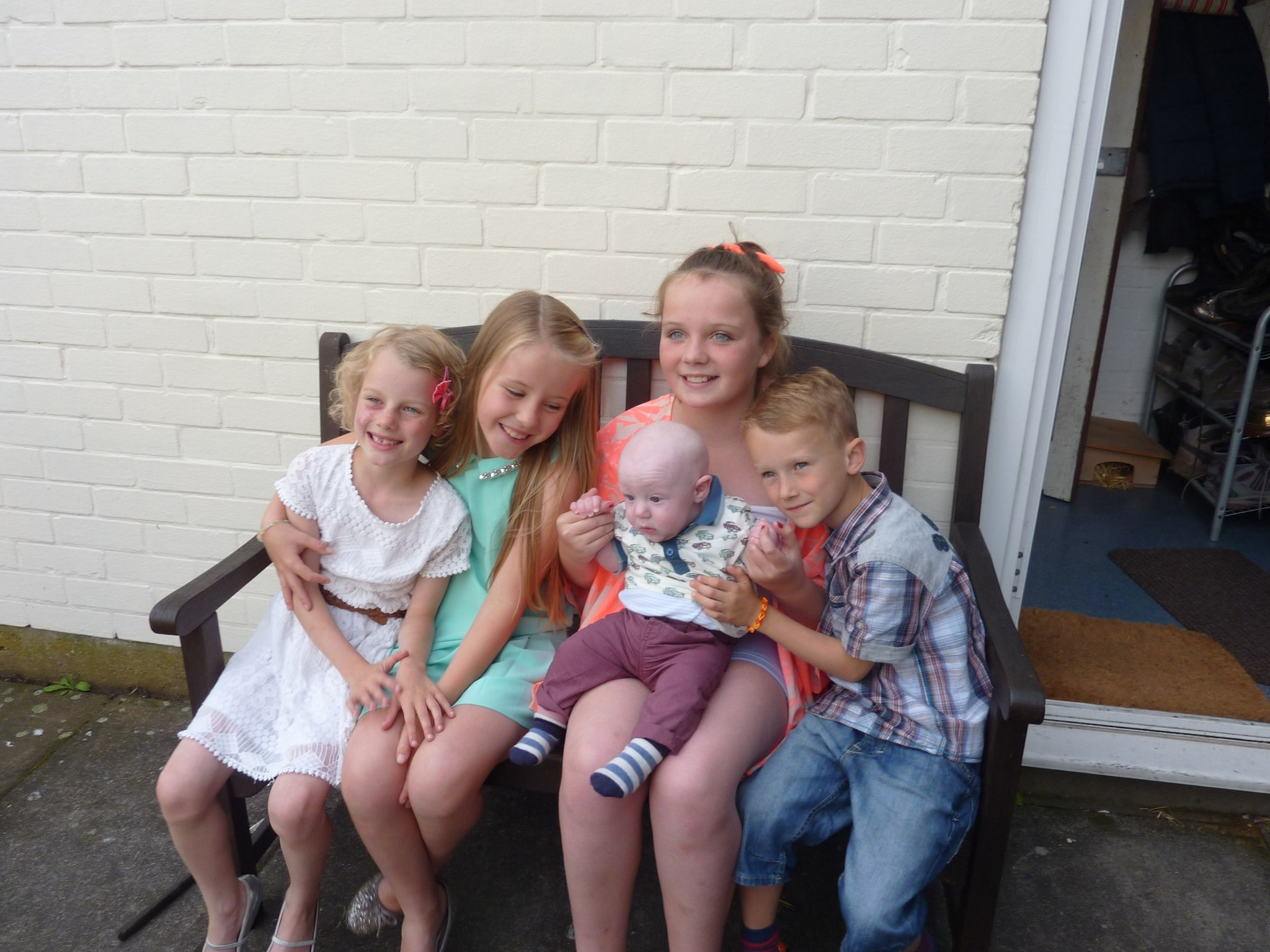 Elizabeth & Alice with their cousins Amelie, Luke and Archie. Elizabeth would always help out with her younger cousins who loved to play with her, she was a caring & kind hearted little girl with a beautifu smile.