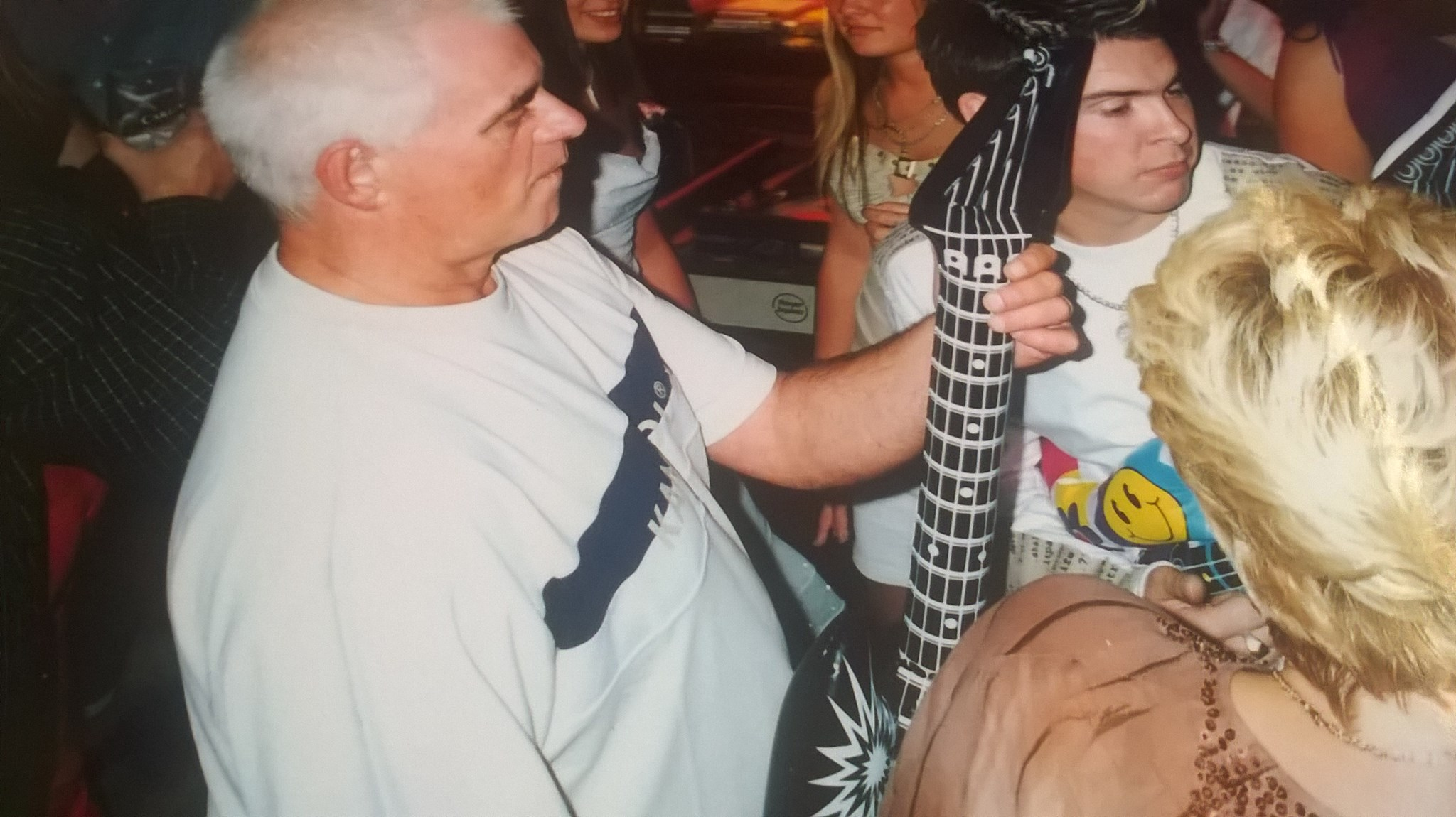 playing the inflatable guitar at mine and mums joint 21st/50th party