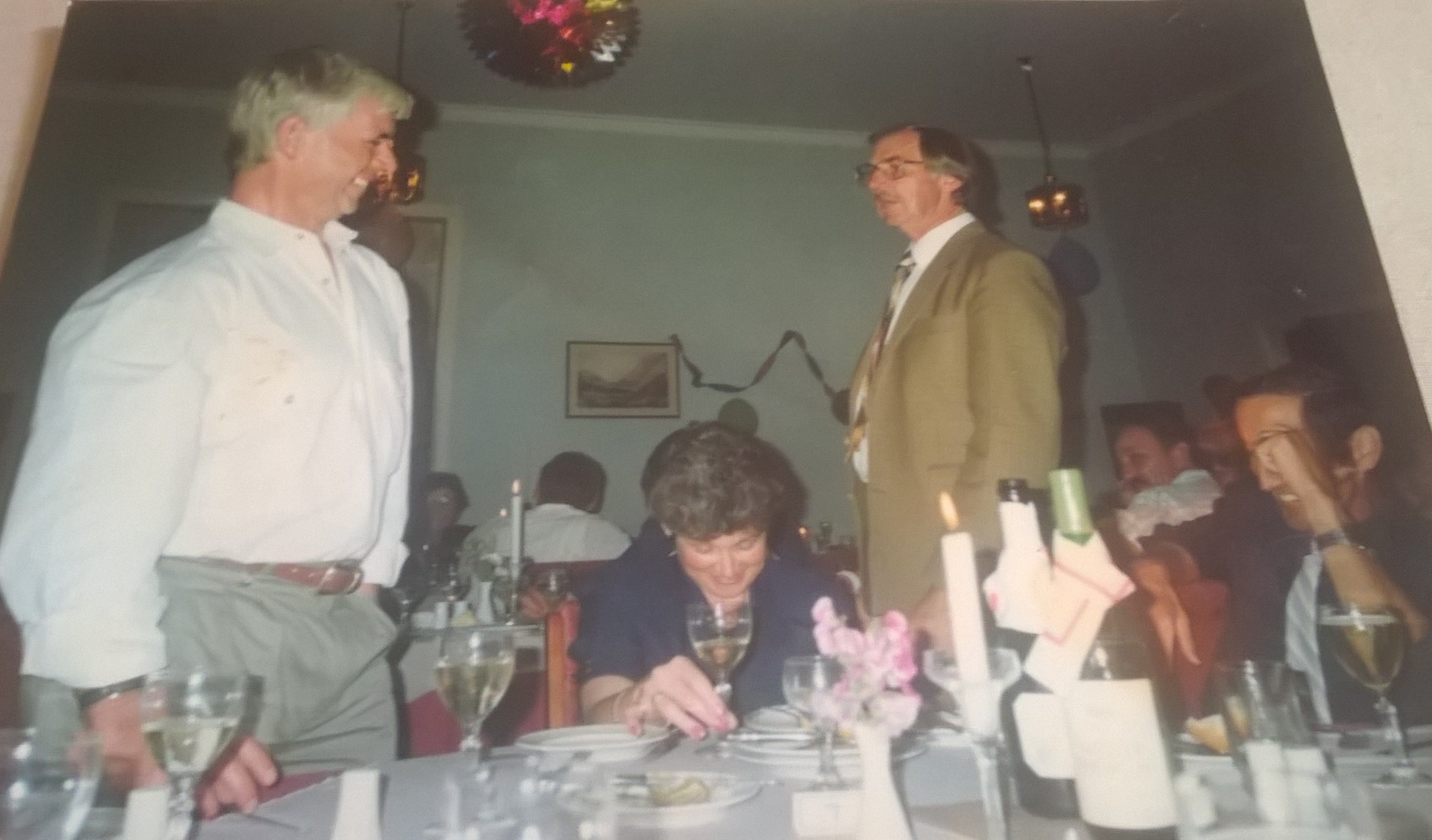 fawlty towers evening in NZ, Bazil looking for dads tie to cut up..but dad had whipped it off and hidden it , just in time lol, happy memory x