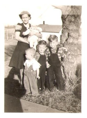 Sweet family photo with Grandma Mary, John, Don, Paulie and Jean