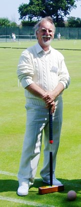Robin posing for the camera after a game of croquet