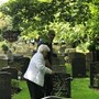 Aurelia and son Dario visiting graves of husband Alan and parents George and Marjorie Hall