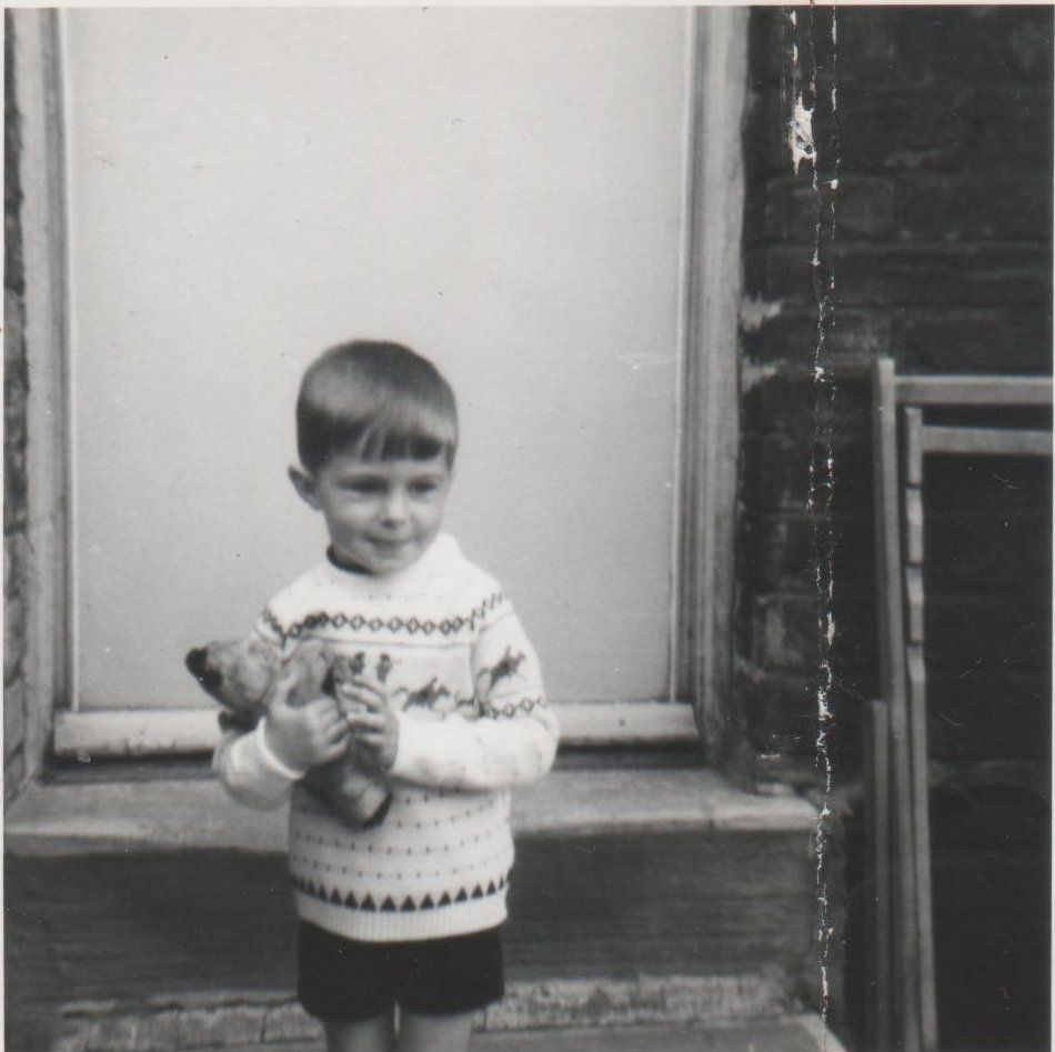 Alek with his favourite teddy bear,aged 4