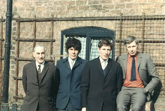 Brian (second left) with his father Charlie and brothers Frank and David (far right)
