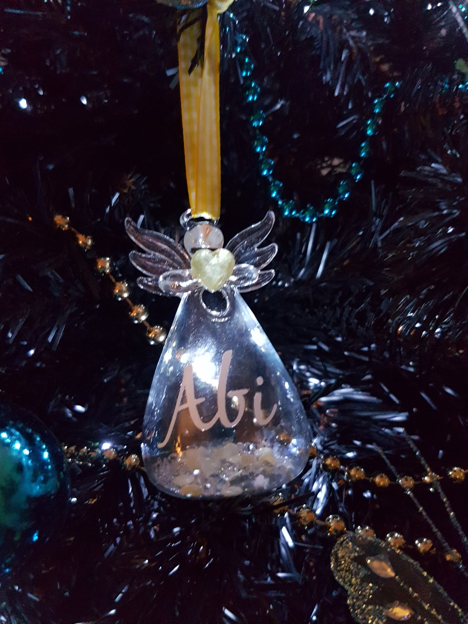 Pride of place on our tree bish we miss you like crazy xxx