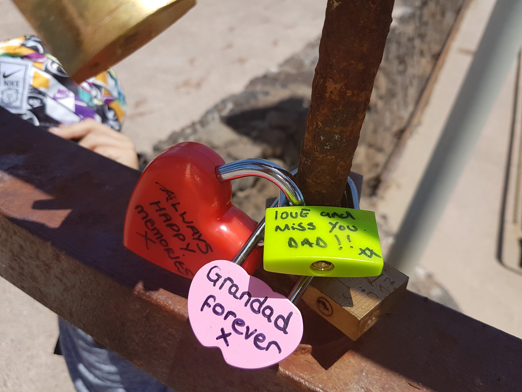Dads padlocks in lanzarote big love lock (hear) from mum the green padlock is from Shane and the pink one is from me george and kids yours and mums  padlock is locked round mine georges and kids and shanes because u and mum always  hold us together x