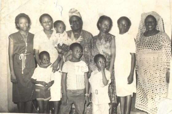 Iyetade, far left, with grandpa and grandma Idowu and clan of cousins