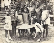 Iyetade with family when young.