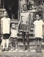 Iyetade as a child with her family.