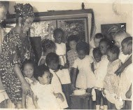 Iyetade and family at a young birthday party.