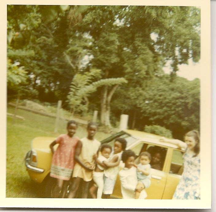 Iyetade holding her brother Ilemakin, and Peyibomi carrying her cousin Lara, UI 1972