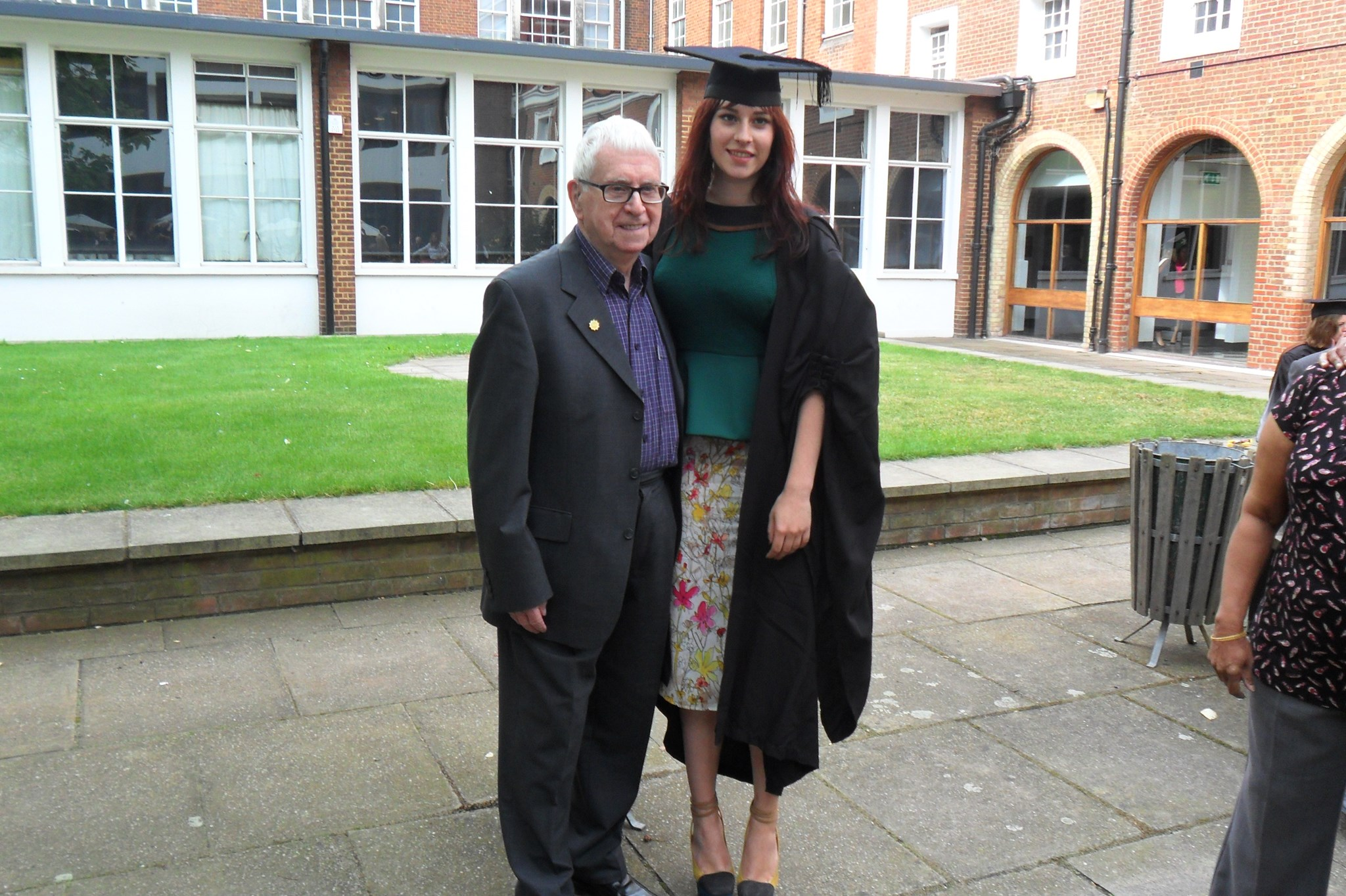 Paul, so proud, with his Granddaughter Olivia on her Graduation Day.
