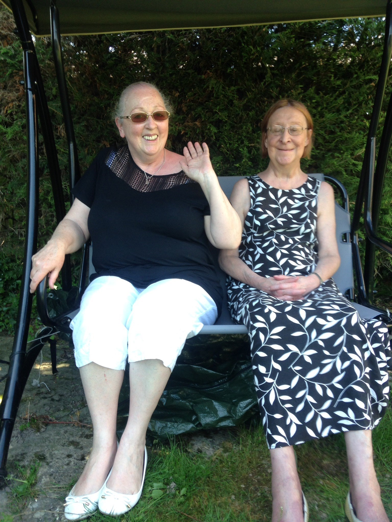 Bernadette with Rose after Polish cakes in the garden.