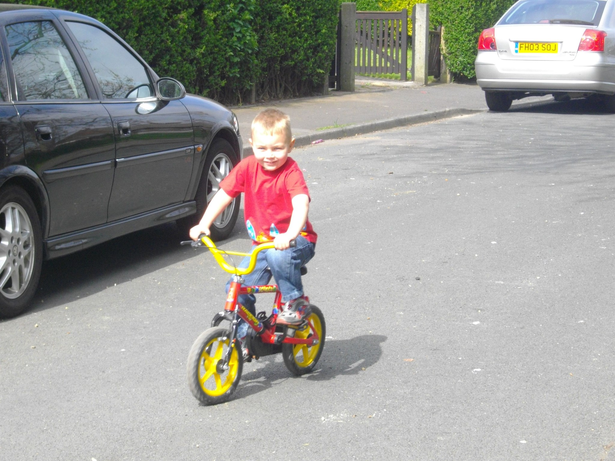 learning t ride his bike, it took all ov half a day :] x