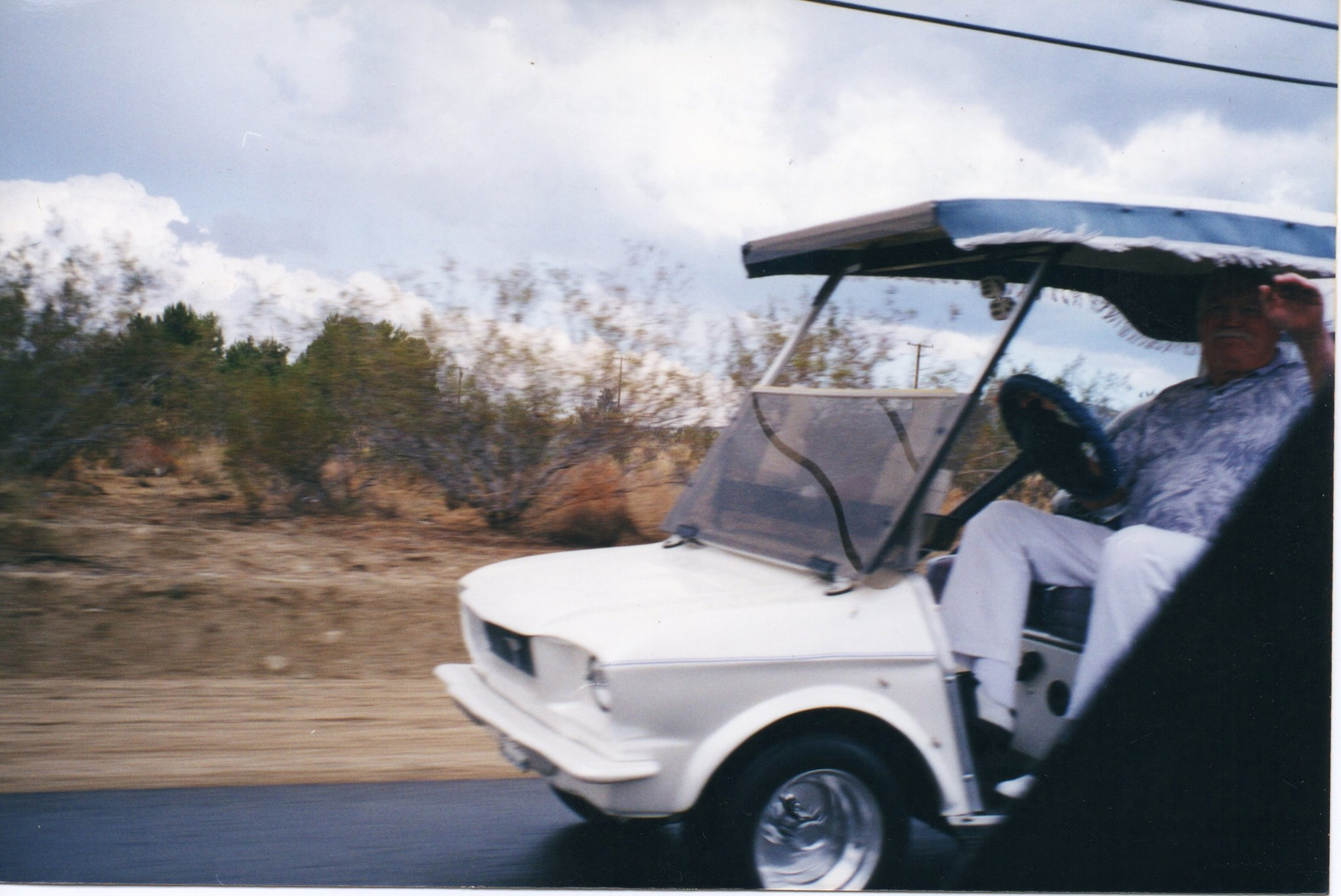 Glen on his custom-made golf cart - Sept. 2001