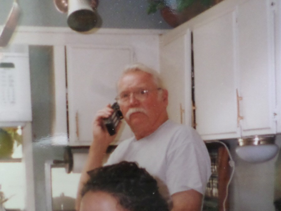 Glen on the phone at home