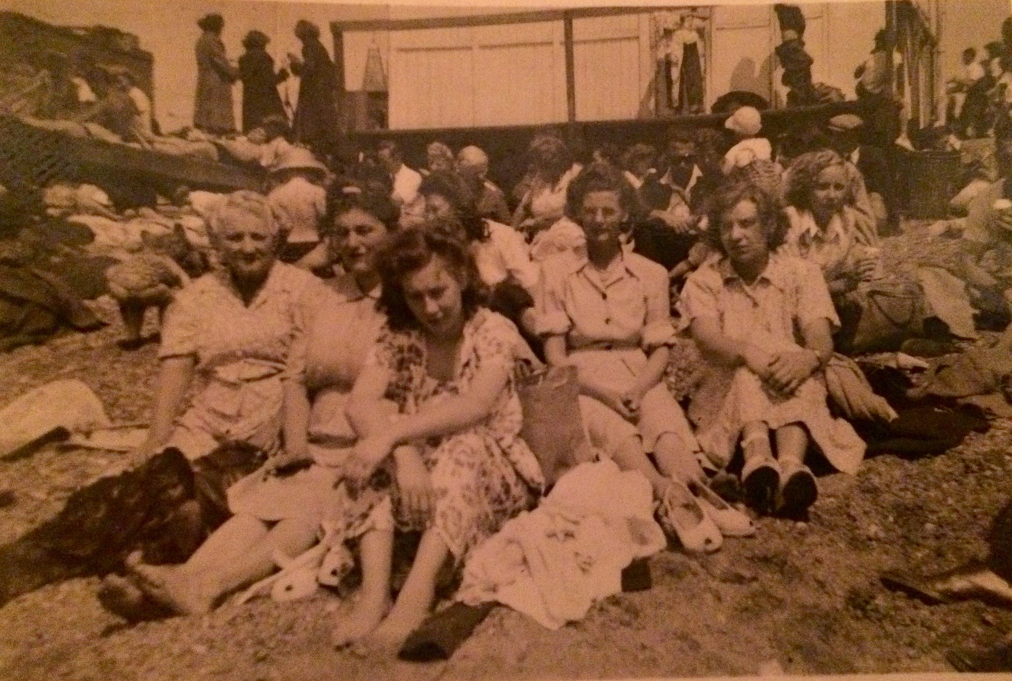 Joyce on the beach with family and friends